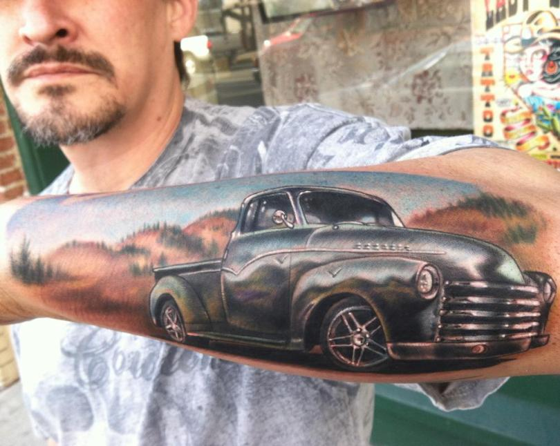 Crazy Black And Red Color Ink Car Tattoo On Forearm For Boys