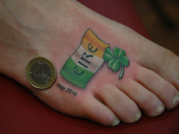 Crazy White Green And Yellow Color Ink Irish Flag Tattoo On Foot For Boys