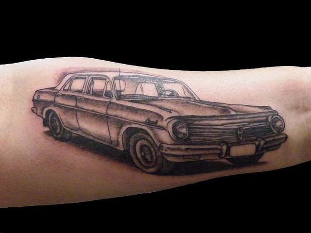 Creative Black And Red Color Ink Car Tattoo Design On Arm For boys