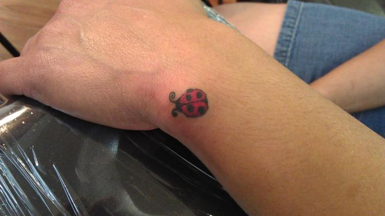 Creative Black And Red Color Ink Little Lady Bug Tattoo On Wrist For Boys