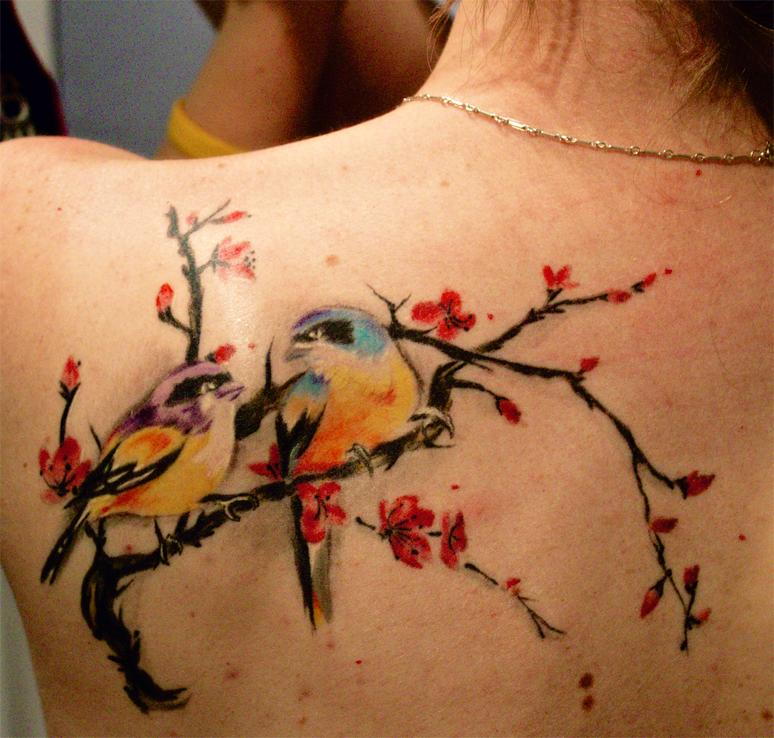 Creative Blue Yellow Black And Red Color Ink Cherry Blossom With Birds Tattoo On Upper Back For Girls