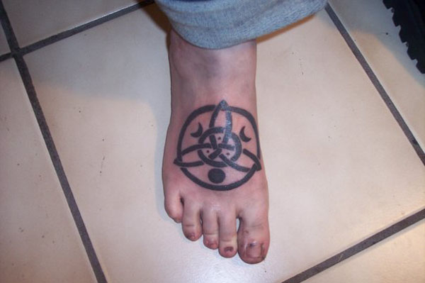 Cute Black Color Ink Celtic Triquetra Tattoo On Foot For Girls