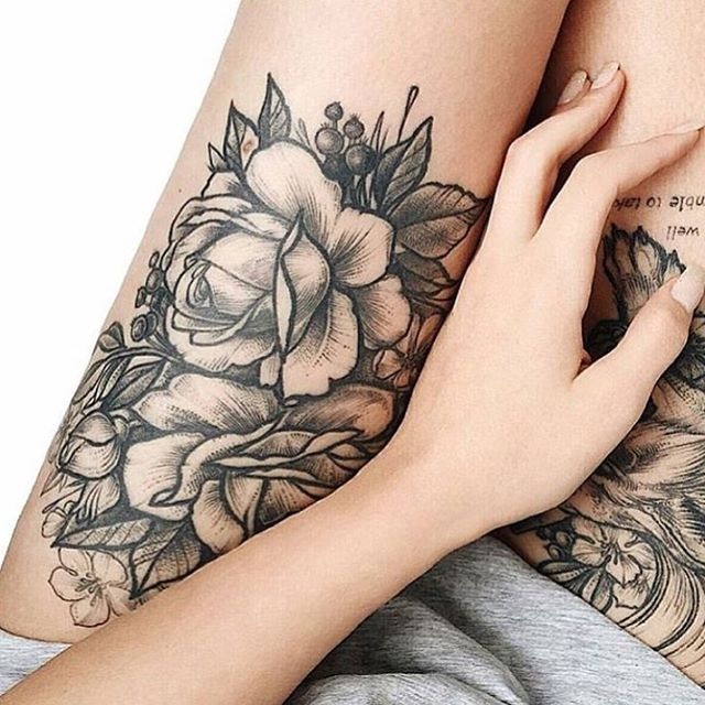Dashing Rose Tattoo For Females On Thigh