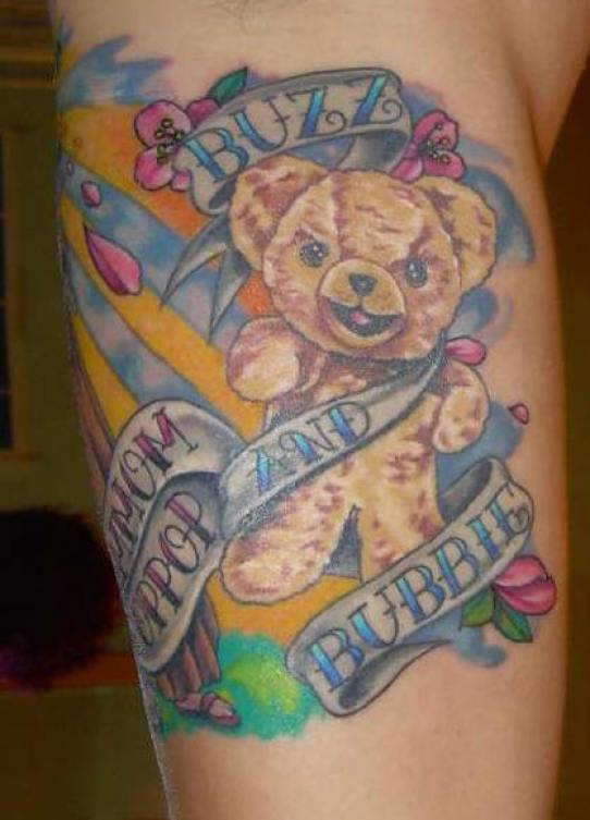 Dreamcather Blue Yellow And Pink Color Ink Teddy Bear Tattoo With Banners For Girls On Arm