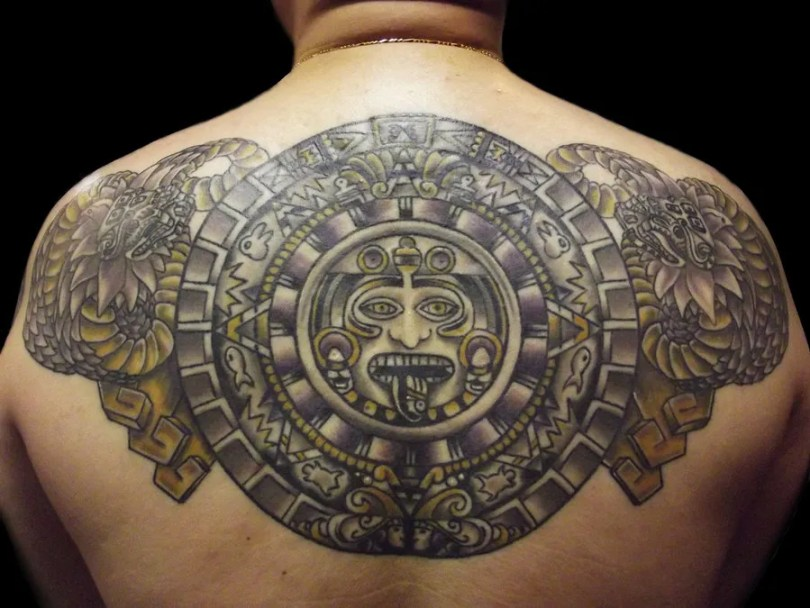 Elegant Black And Yellow Color Ink Aztec Mayan Calendar Tattoo Surrounded By Mayan Serpent Heads For Boys