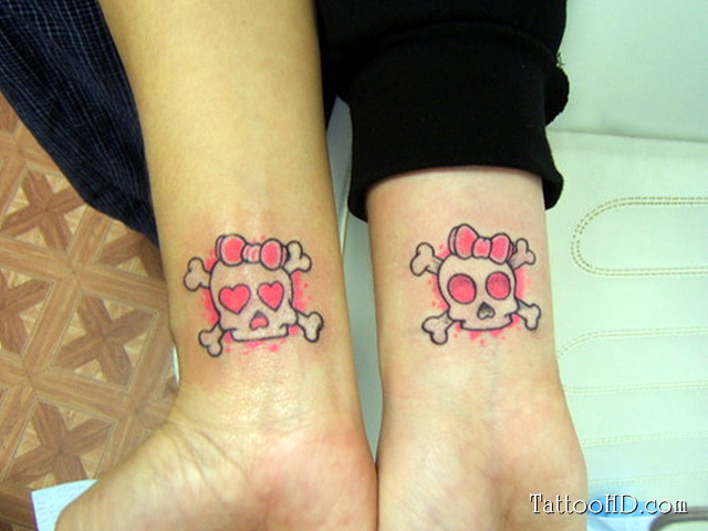Elegant REd And Black Color Ink Matching Skull Tattoo On Wrists For Girls