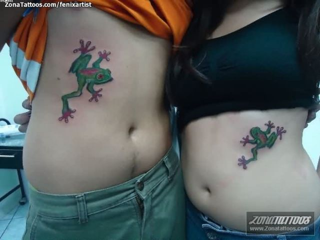 Extremely Green And Red Color Ink Aqua Tattoo On Rib Sides For Girls