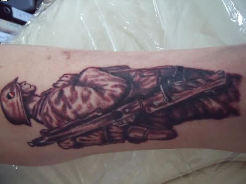 Famous Black And Red Color Ink Army Man Carrying Rifle Tattoo Design On Arm For Boys