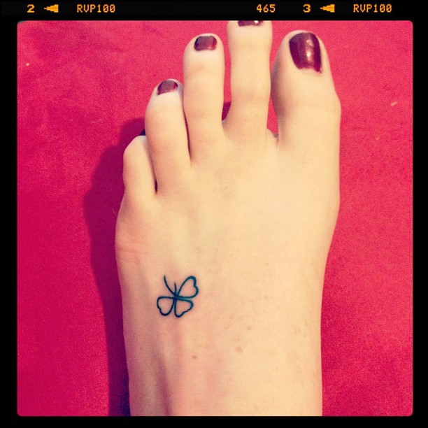 Fantastic Black And Green Color Ink Clover Foot Tattoo Image For Girls