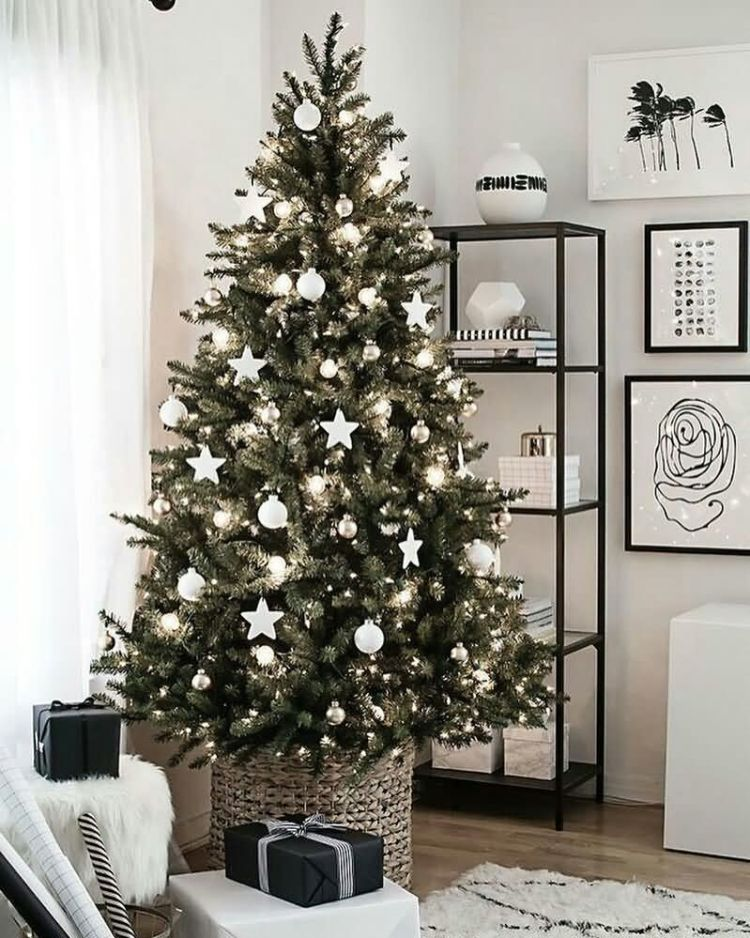 Fantastic Christmas Tree Decorated With White Lights And Stars