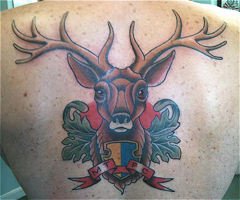 Fantastic Green Black And Red Color Ink Deer Tattoo On Upper Back For Boys