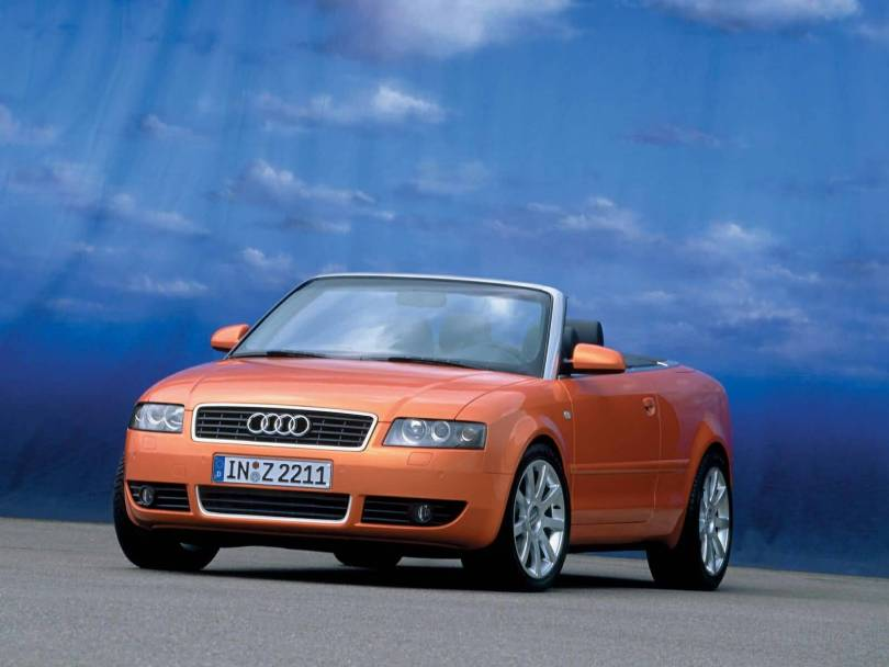 Front side View of Beautiful orange colour Audi A4 Cabriolet car