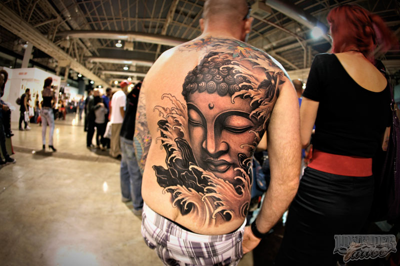 Glowing Black And Brown Color Ink Buddhist Tattoo On Back For Boys Only