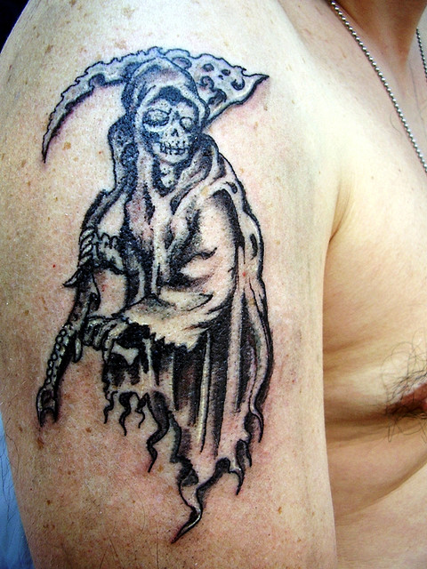 Great Black Color Ink Death Tattoo On Upper Arm For Boys