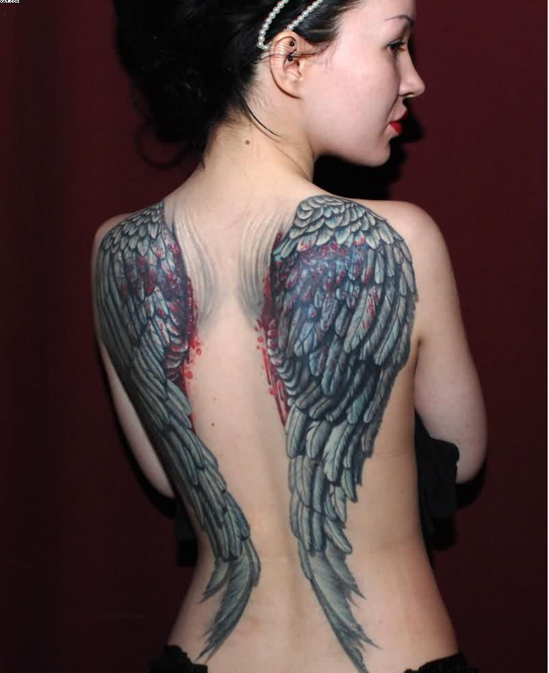 Great Wings Tattoo Of A bird On Back With Great Ink