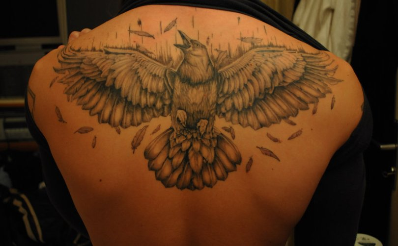 Groovy Black Color Ink Open Wings Crow Tattoo On Upperback For Boys