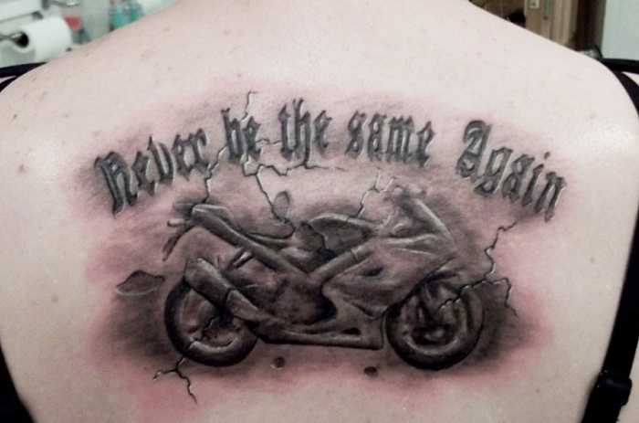Groovy Black Color Ink Upper Back Racing Bike Tattoo On Back For Girls