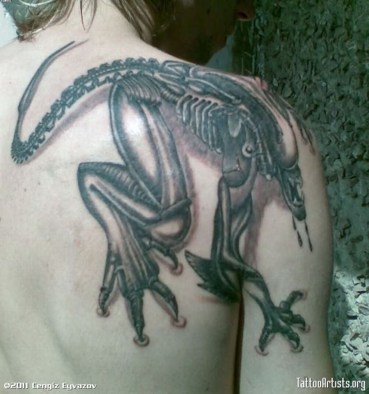 Groovy Grey Color Ink Alien Tattoo On Shoulder For Girls