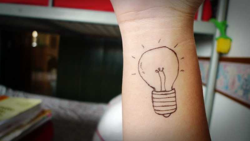 Horrible Black And Red Color Ink Bulb Outline Tattoo On Wrist For Girls Copy