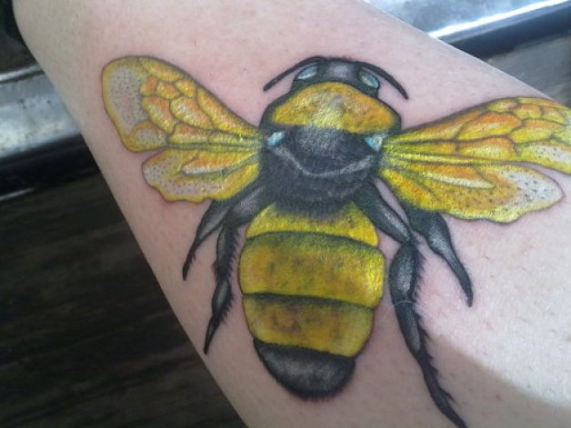 Horrible Black And Yellow Color Ink Bumblebee Tattoo Design On Arm For Girls