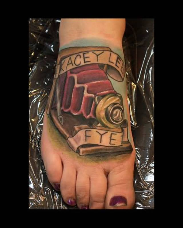 Horrible Blue Black And Red Color Ink Camera Foot Tattoo For Girls