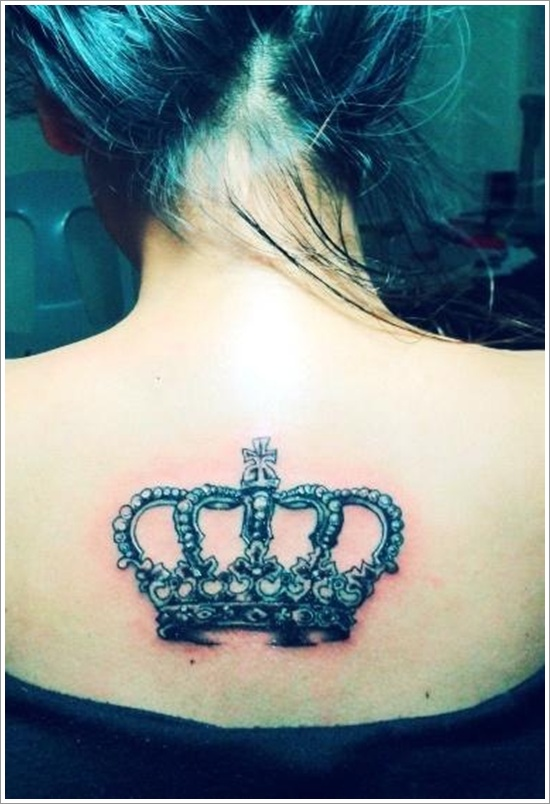 Horrible Blue Color Ink Crown Tattoo On Upper Back For Girls