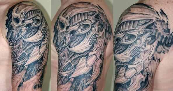 Horrible Grey Color Ink Biomechanical Skull Tattoo On Shoulder For Boys