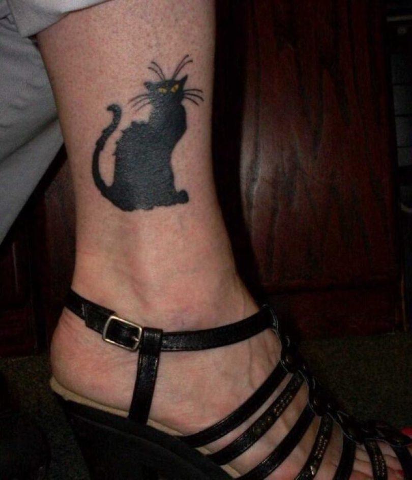 Impressive Black Color Ink Black Cat Tattoo On Ankle For Girls