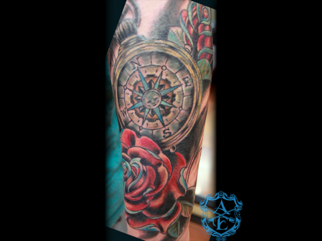 Impressive Blue Red Black And Green Color Ink Compass Rose Tattoo Design For Girls