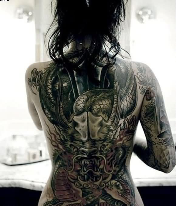 Incredible Back Dragon Women Tattoo With Black Ink