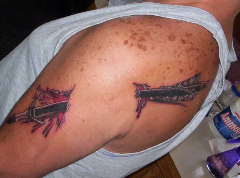 Incredible Black And Red Color Ink 3D Archery Arrow Through Arm Tattoo For Guys On Shoulder