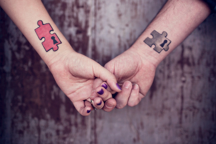 Incredible Red And Black Color Ink Puzzle Couple Tattoo Designs For Couple