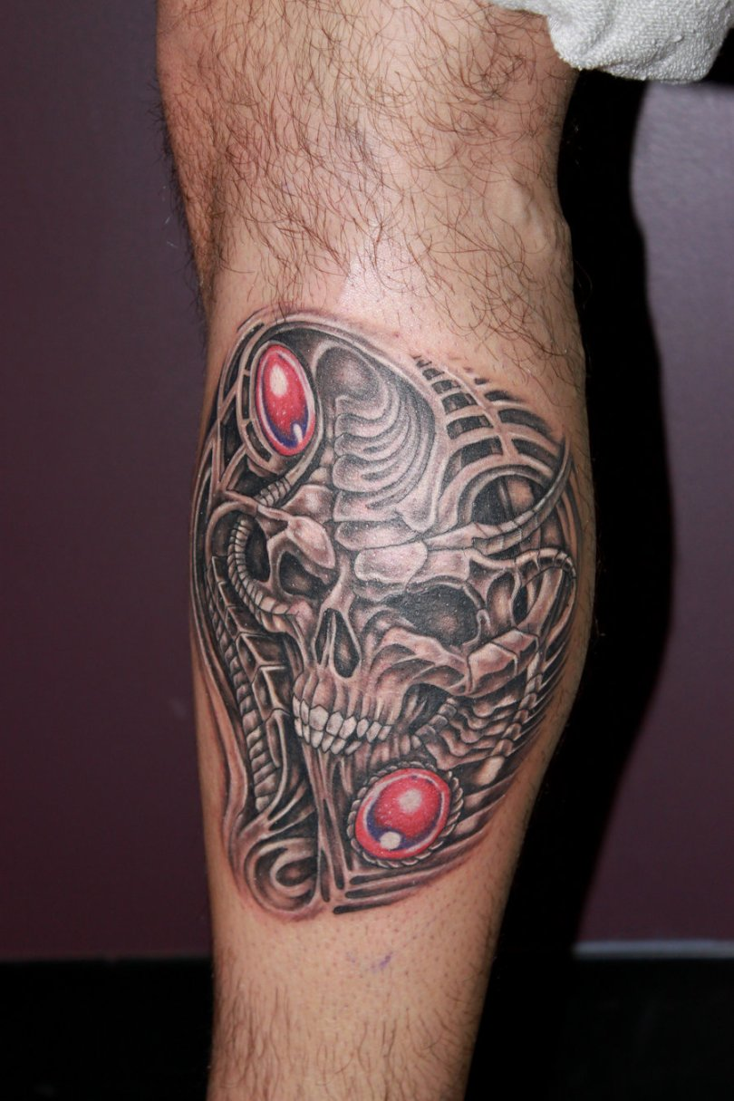 Innovation Red And Grey Color Ink Biomechanical Skull Tattoo On Leg For Boys