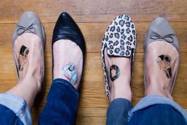 Inspiring Black And White Color Ink Camera Tattoo On Feet For Girls