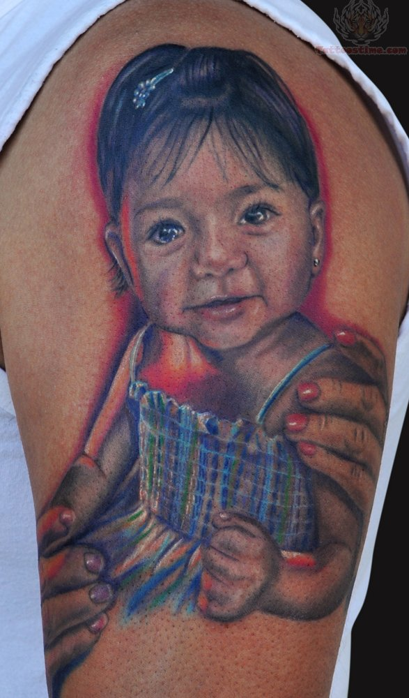Latest Red Blue And Black Color Ink Baby Tattoo On Biceps For Boys