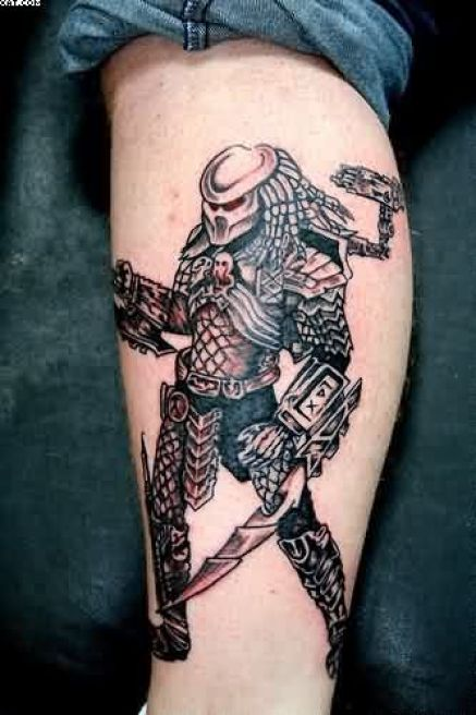Lovely Black Color Ink Alien Warrior Tattoo On Arm For Boys