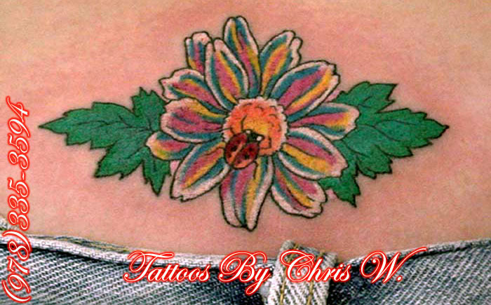 Lovely Green Blue Black And Red Color Ink Lady Bug On Flower Tattoo For Girls