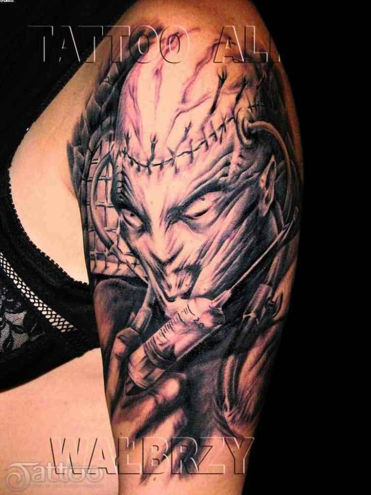 Maori Black And Red Light Color Ink Half Sleeve Evil Alien Tattoo Design On Shoulder For Girls