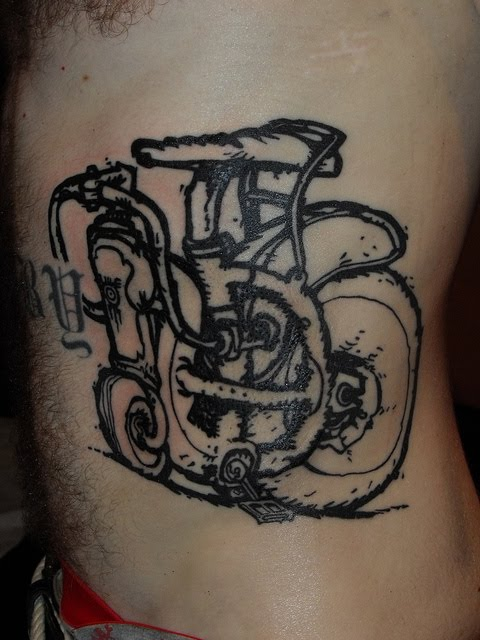 Maori Black Color Ink Eroded City Cycle Tattoo Design For Boys