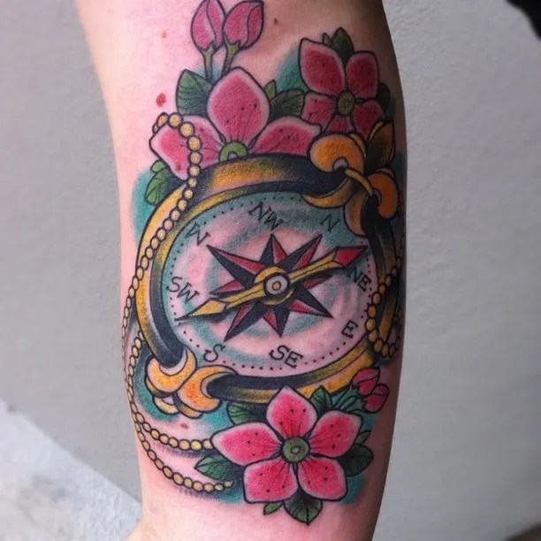 Maori Blue Green Black And Red Color Ink Compass With Pink Flowers Tattoo Design For Girls