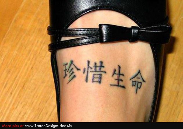 Marvel Black Color Ink Chinese Symbol Tattoo On Foot For Girls