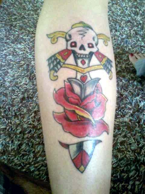 Marvel Yellow Red And Black Color Ink Skull Dagger Tattoo Design For Girls