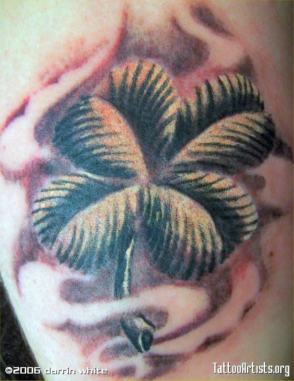 Marvelous Black And Green Color Ink Four Leaf Clover Tattoo Design For Boys