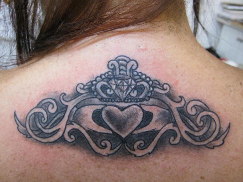 Mind Blowing Black Color Ink Upper Back Claddagh Tattoo Design For Girls