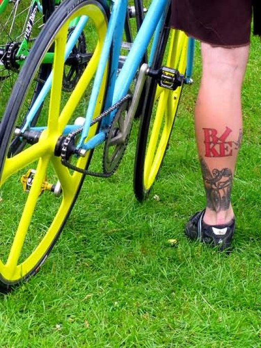 Mind Blowing Red And Black Color Ink Bike Tattoo On Ankle For Boys
