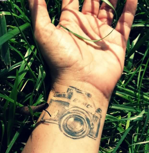 Most Amazing Camera Tattoo On Wrist With Grass