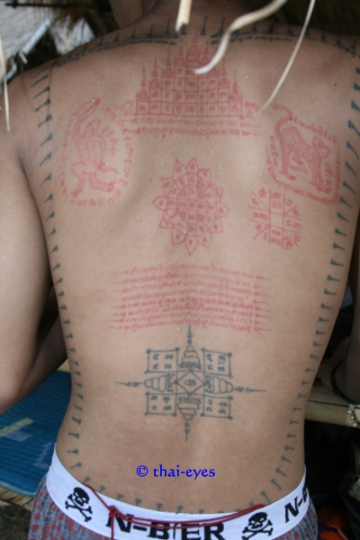 Nice Grey And Red Color Ink Thai Buddhist Tattoo On Back Body For Boys