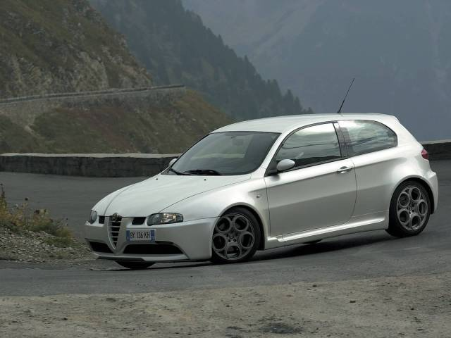 On the road fast White colour Alfa Romeo 147 GTA Car