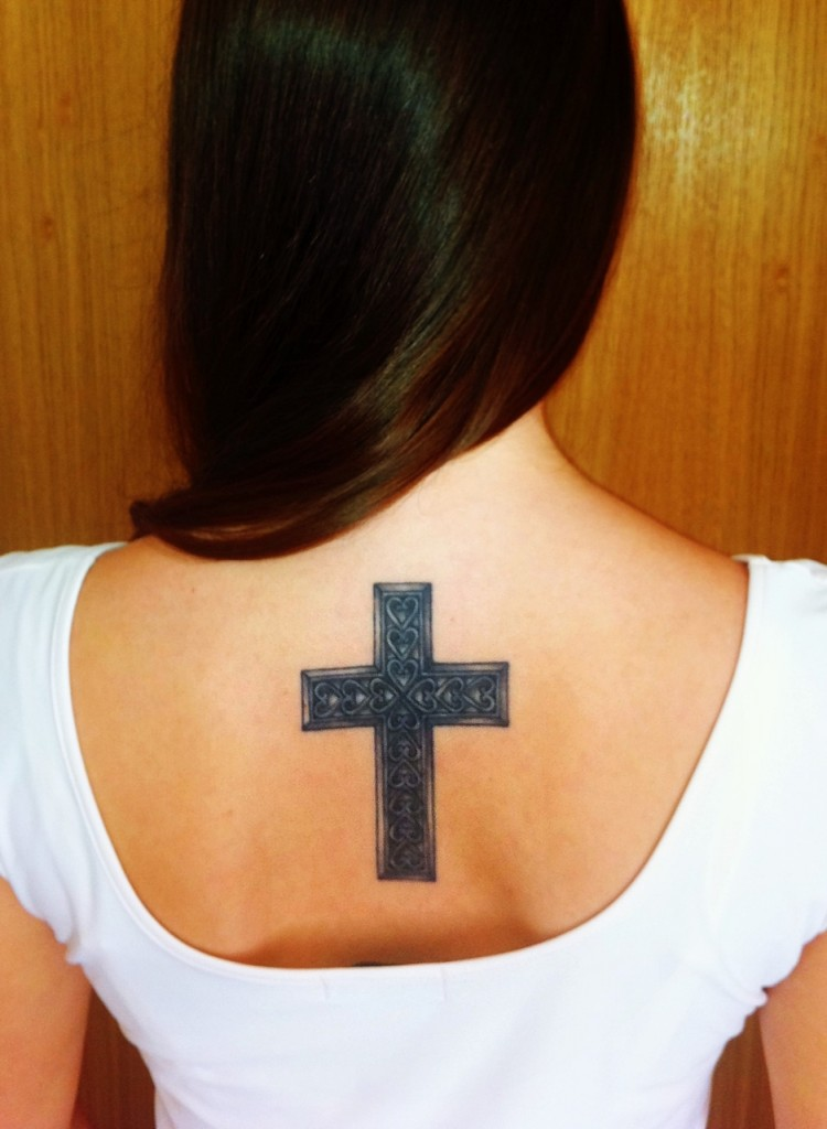 Out Standing Black Color Ink Celtic Cross Tattoo On Upper Girl's Back