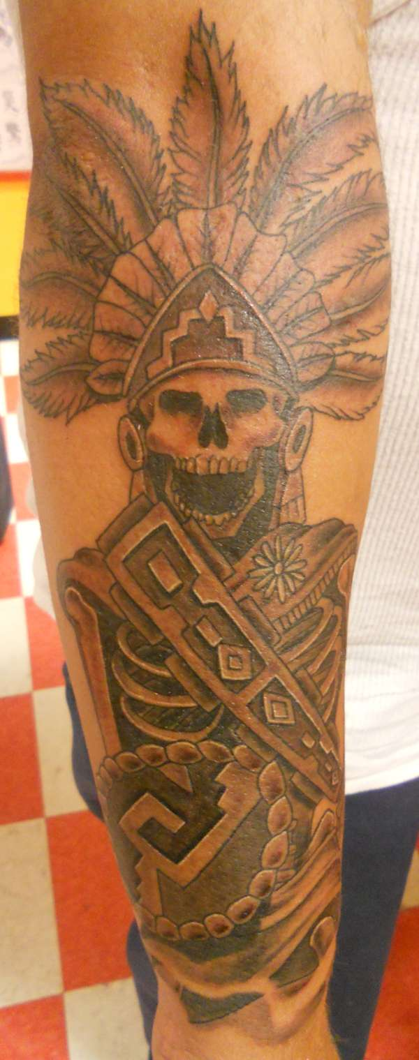 Passionate Black And Yellow color Ink Aztec Skull Warrior Tattoo On Arm For Boys